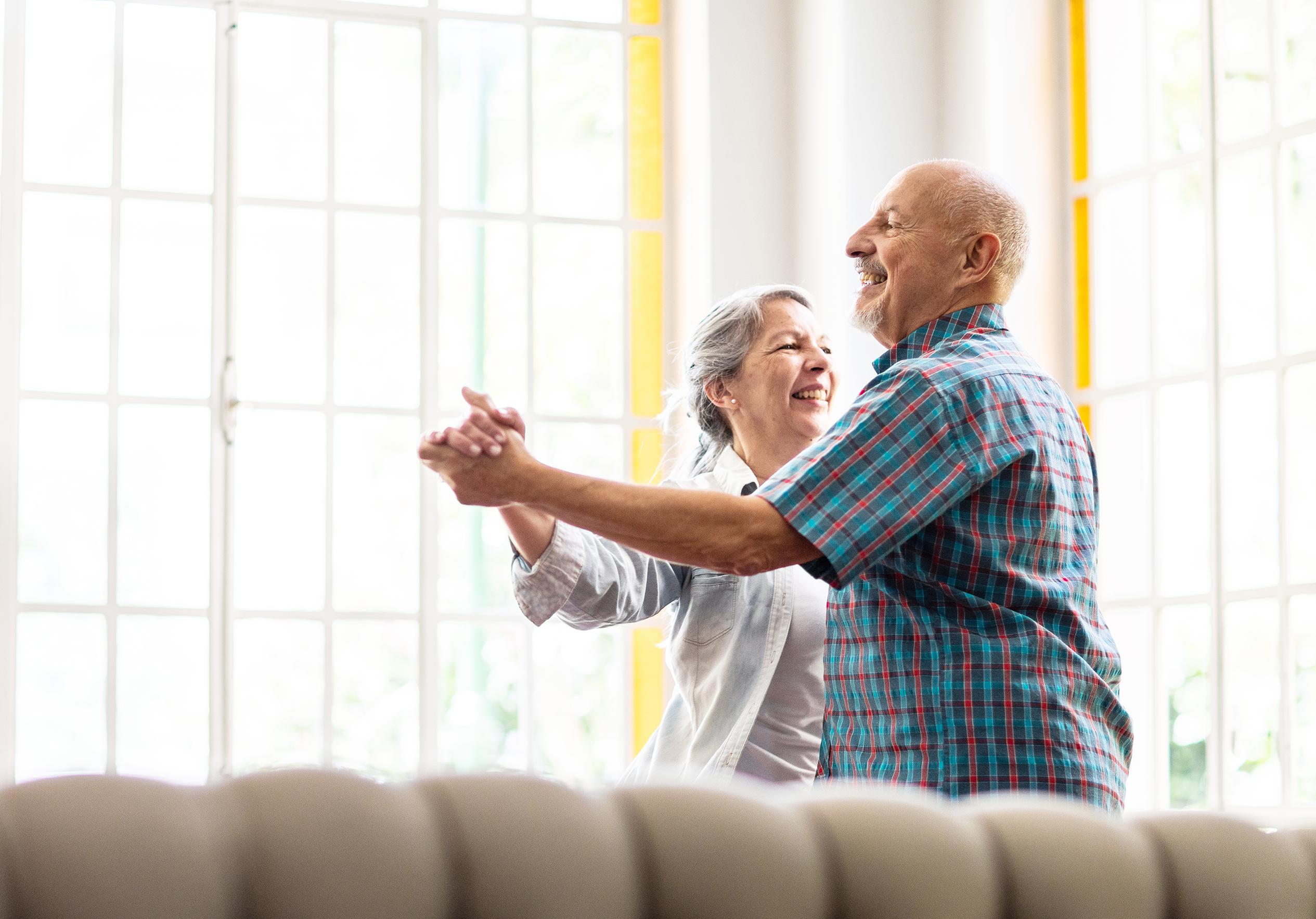 An elderly couple dancing, stress free.